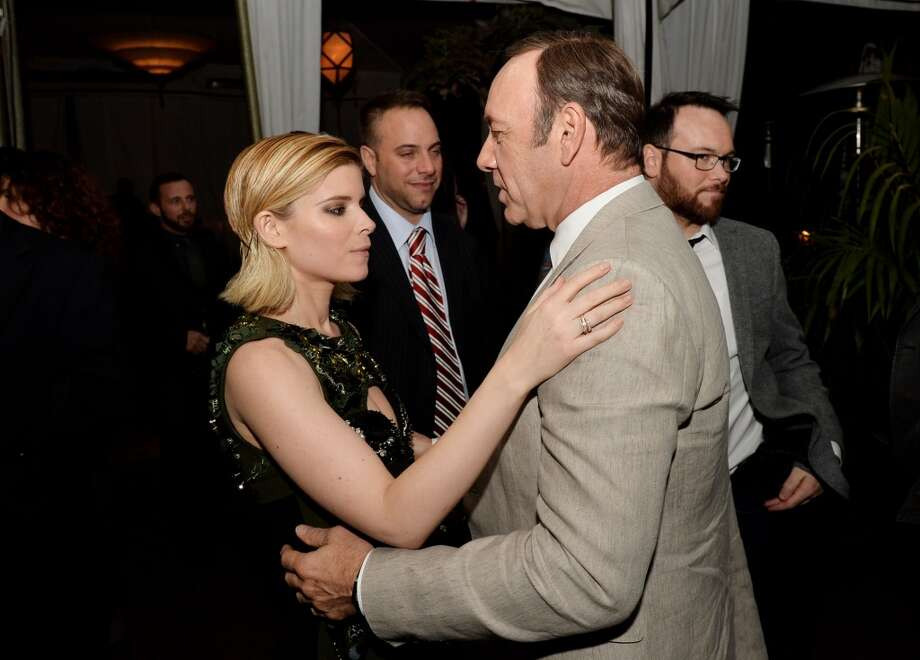 "Actress Kate Mara (L) and executive producer/actor Kevin Spacey talk at the after party for a special screening of Netflix's ""House of Cards"" Season 2 at the Chateau Marmont on February 13, 2014 in West Hollywood, California. Photo: Kevin Winter, Getty Images"