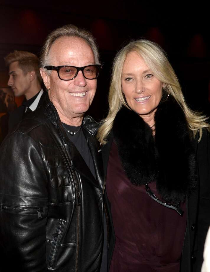 "Actor Peter Fonda (L) and Margaret DeVogelaere arrive at the special screening of Netflix's ""House of Cards"" Season 2 at the Directors Guild Of America on February 13, 2014 in Los Angeles, California. Photo: Kevin Winter, Getty Images"