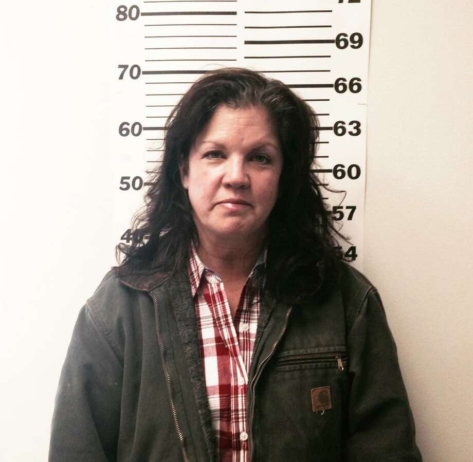 Kimberly Ann Adams, 50, of New Caney, is charged with animal cruelty in the neglect of her horses.