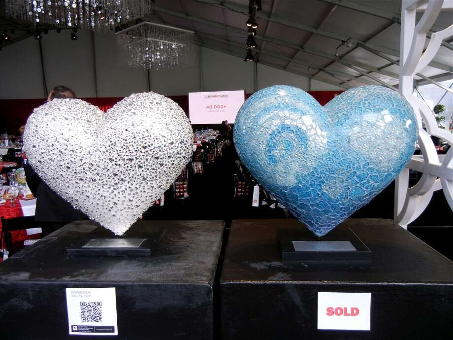 A Swarovski crystal table-top heart (at left) was a sparkling addition to the auction Photo: Catherine Bigelow