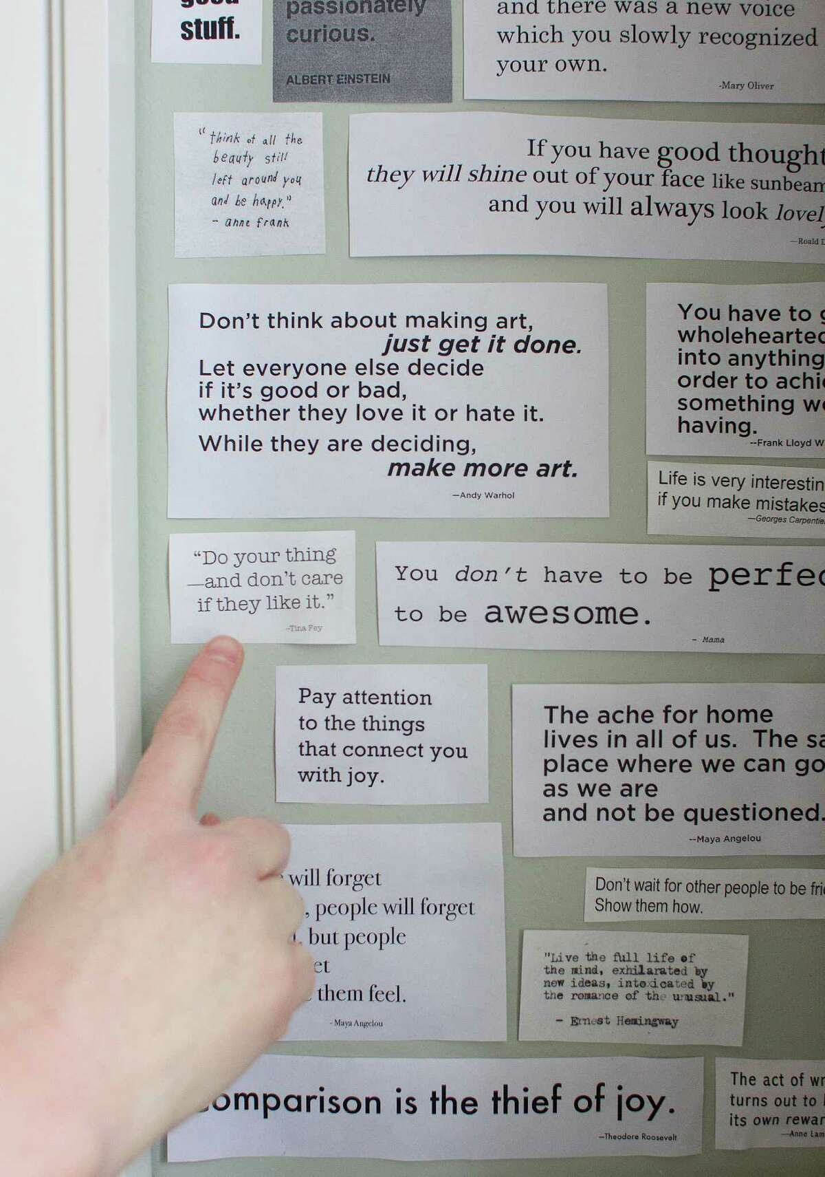 Katherine Center points to one of her favorite quotes on her bathroom wall - one by Tina Fey.