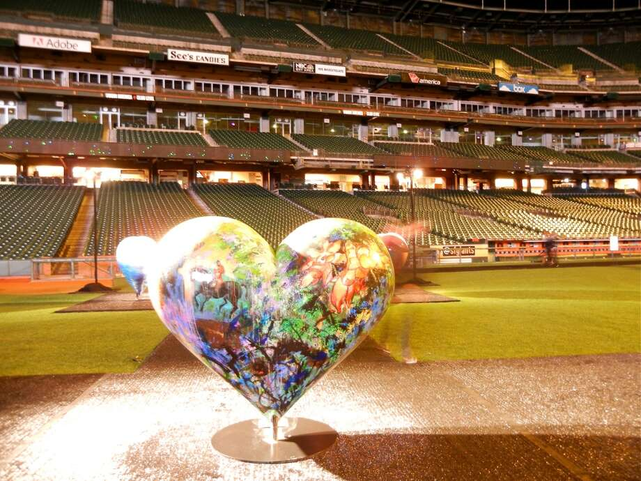 Large-scale hearts dotted the infield and were earlier auctioned off to raise funds for the S.F. General Hospital Foundatin Photo: Catherine Bigelow
