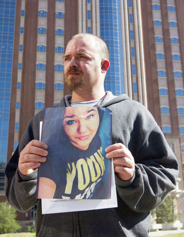 Corriann Cervantes' father Cory holds a picture of her as he speaks to members of the media during a press conference held outside the Harris County Criminal Justice Center on Friday, Feb. 14, 2014, in Houston.  Authorities claim a 16-year-old, whose name is not being released because of his age, and 17-year-old Jose E. Reyes sexually assaulted and then killed Corriann Cervantes in a vacant apartment on Feb. 5 in an effort to make a deal with the devil. Photo: J. Patric Schneider, For The Chronicle / © 2014 Houston Chronicle