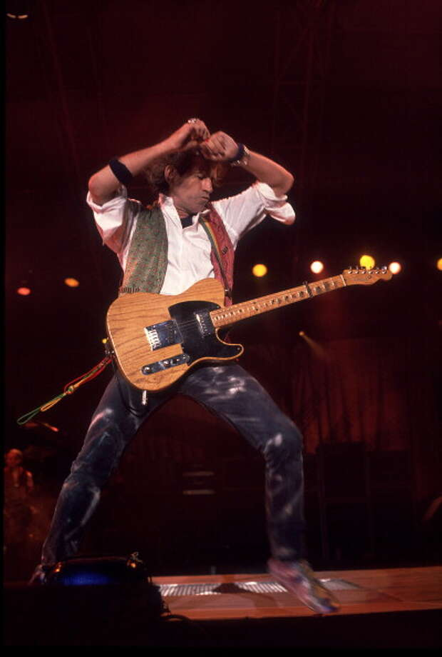 British musician Keith Richards of the Rolling Stones performs on stage during the band's 'Steel Wheels' tour, late 1989. (Photo by Paul Natkin/Getty Images) Photo: Paul Natkin, Getty Images / Archive Photos