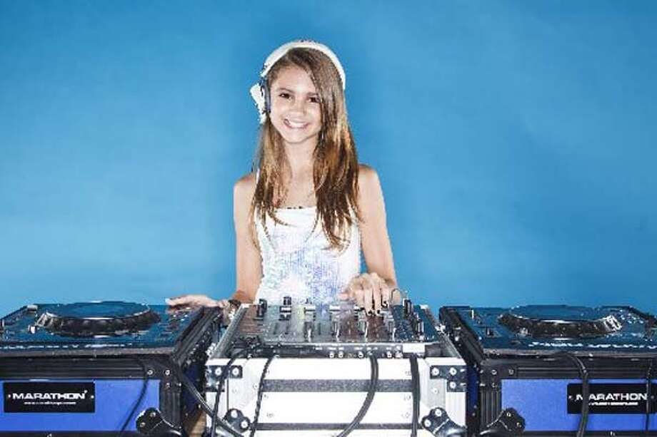 DJ Elle Morgan is one of the city's most in-demand DJs, spinning regularly at Hughes Hangar and in the Woodlands. Photo: Michael Paulsen / Houston Chronicle