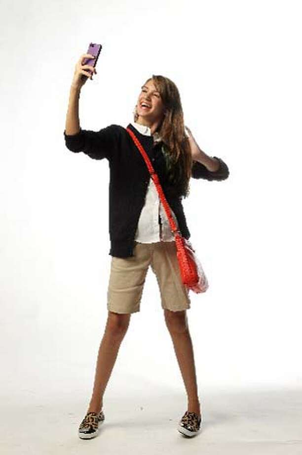 DJ Elle Morgan wears a back-to-school outfit on Monday, July 29, 2013, in Houston. Photo: Mayra Beltran / Houston Chronicle