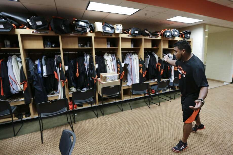 San Francisco Giants pitcher Jean Machi jokes in the locker room during baseball spring training Friday, Feb. 14, 2014, in Scottsdale, Ariz. Giants pitchers and catchers arrived Friday for physicals before beginning training Saturday. Photo: Gregory Bull, Associated Press