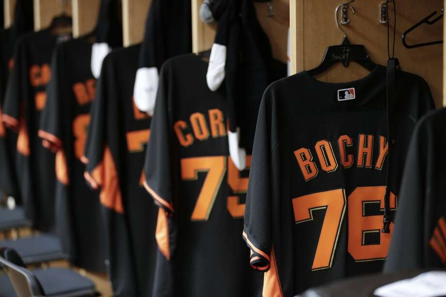 San Francisco Giants uniforms line the locker room during spring training baseball practice Friday, Feb. 14, 2014, in Scottsdale, Ariz. Giants pitchers and catchers arrived Friday for physicals before beginning training Saturday. Photo: Gregory Bull, Associated Press