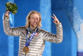 US gold medalist Sage Kotsenburg poses with his medal on the podium of the Men's Snowboard Slopestyle event of the Sochi Winter Olympics on February 8, 2014 at the Sochi medals plaza.  AFP PHOTO / ANDREJ ISAKOVICANDREJ ISAKOVIC/AFP/Getty Images