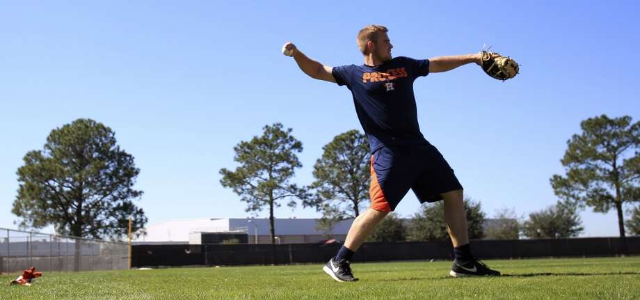 Astros cather Max Stassi throws the ball during a brief workout as preparations were underway in anticipation of the start of the Astros spring training at the Osceola County Stadium in Kissimmee, Fla. Photo: Karen Warren, Houston Chronicle