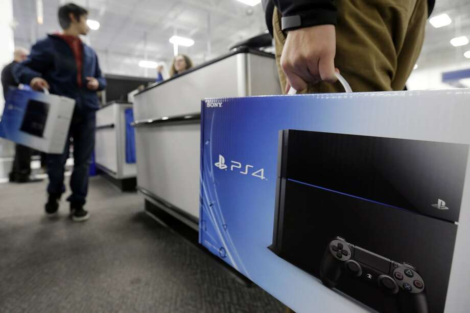 Sales of consoles like PlayStation 4 and Xbox are being closely watched by the gaming industry for shifts in demand. Photo: Nam Y. Huh, Associated Press