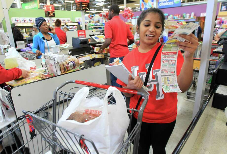 Chishty reviews her total after shopping for a week's worth of groceries with a $25.00 HEB gift card to mimic a food stamp recipient budget. Photo: Mayra Beltran, Houston Chronicle / © 2014 Houston Chronicle