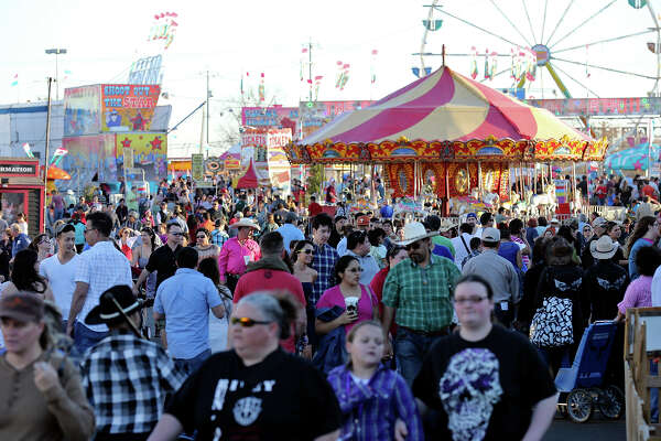 Crowds meander around the Family Fair during the San Antonio Stock Show & Rodeo Friday Feb. 14, 2014.