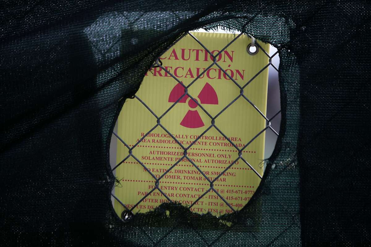 A sign on a fence surrounding Site 31 warns of a radiologically controlled area on Wednesday, September 11, 2013 on Treasure Island in San Francisco, Calif.