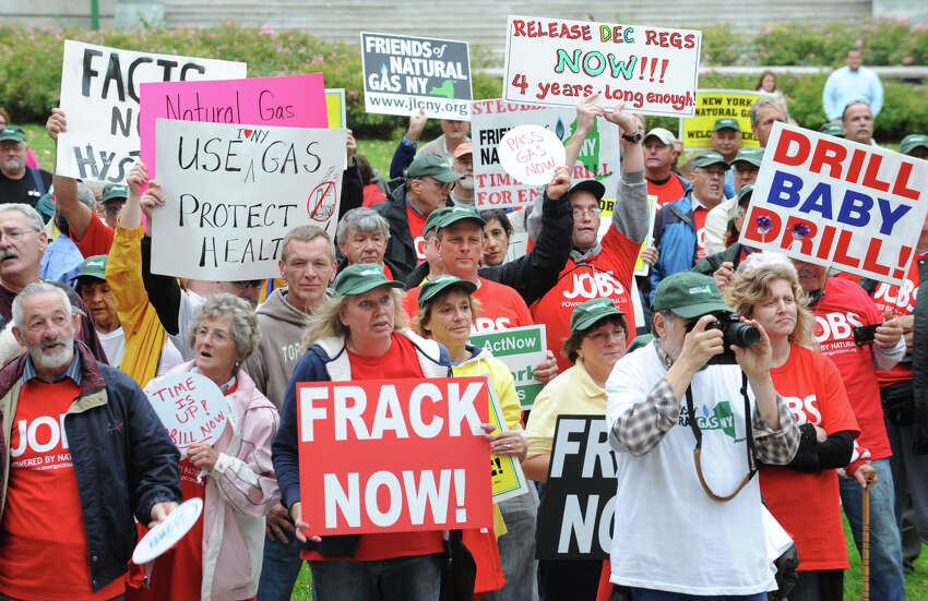 Hyrdofracking supporters hold signs during a rally at the Corning Preserve on Monday, Oct. 15, 2012, in Albany, N.Y. (Lori Van Buren / Times Union archive))
