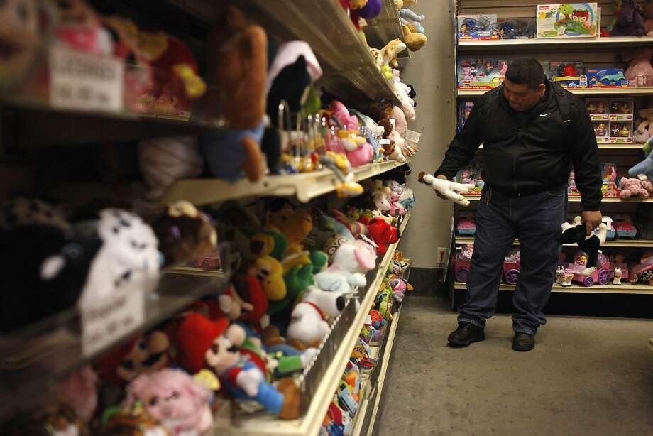 Customer Santos Chan checks out a stuffed animal at Jeffrey's Toys, an old-fashioned store at Market and Third streets. Photo: Lacy Atkins, The Chronicle