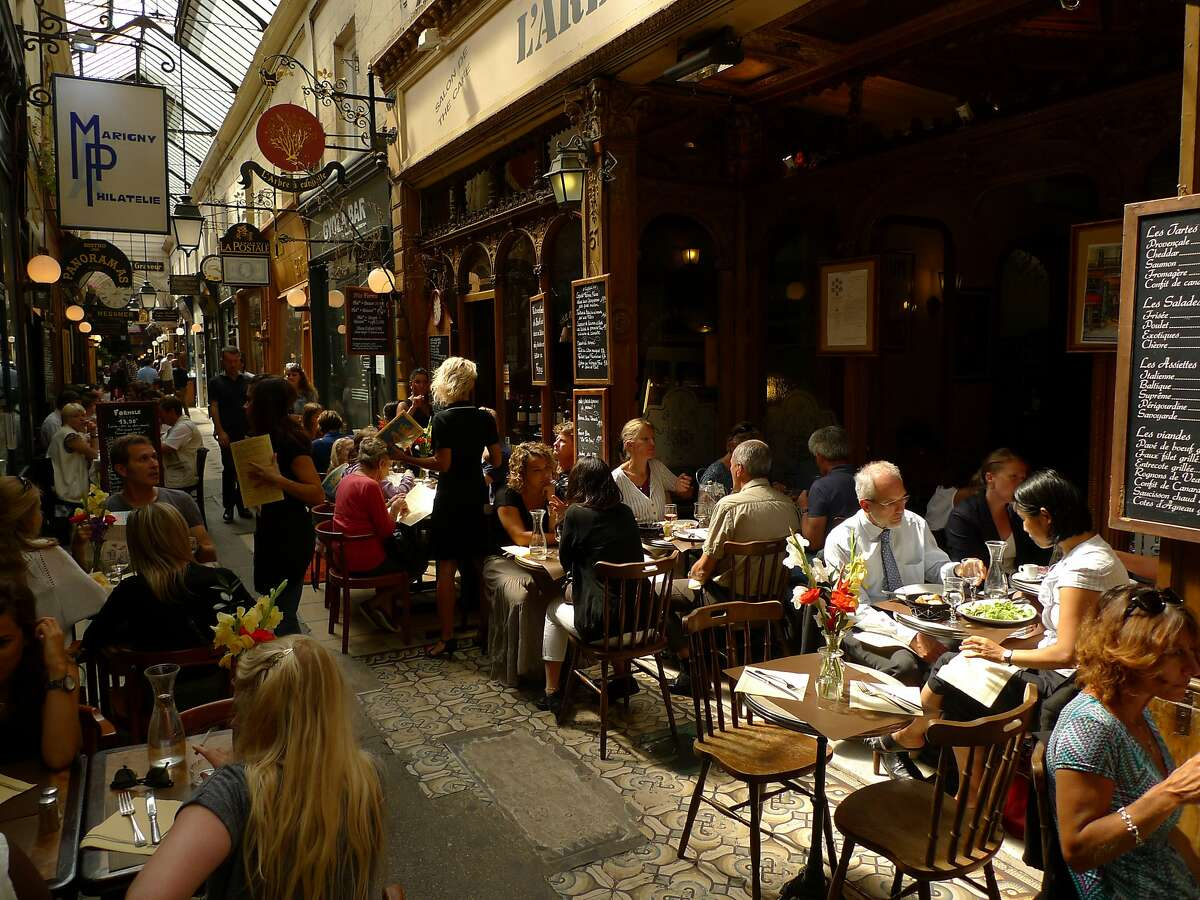 """Lunchtime can be particularly busy in Passage des Panoramas, where several restaurants compete for limited """"sidewalk"""" space."""
