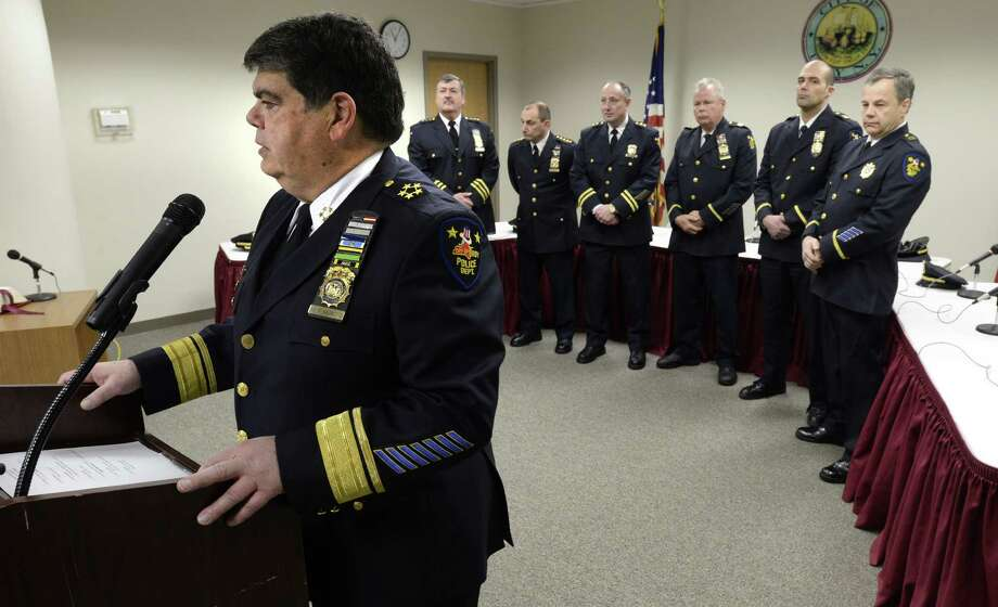 Troy Police Commissioner Anthony Magneto takes the podium for the final time to welcome three new members of the Troy Police Department Friday afternoon, Feb. 14, 2014, in Troy, N.Y.  Magneto leaves the office of Commissioner today.   (Skip Dickstein/ Times Union) Photo: Skip Dickstein / 00025763A