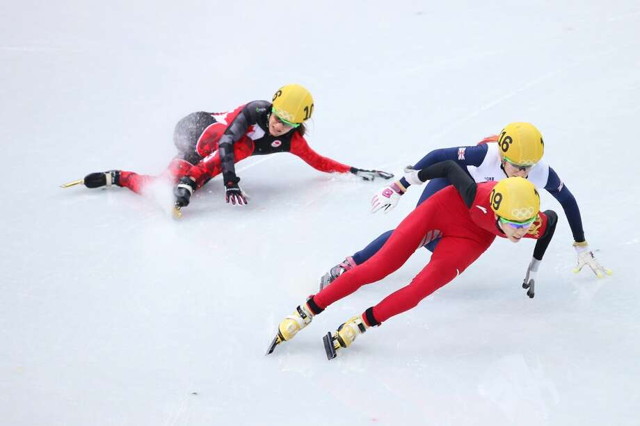 Jessica Hewitt of Canada (L) falls as she competes with Elise Christie of Great Britain (C) and Kexin Fan of China (R) in the Women's Short Track 500m heats on day 6 of the Sochi 2014 Winter Olympics at at Iceberg Skating Palace on February 13, 2014 in Sochi, Russia.  (Photo by Quinn Rooney/Getty Images) Photo: Quinn Rooney, Getty Images