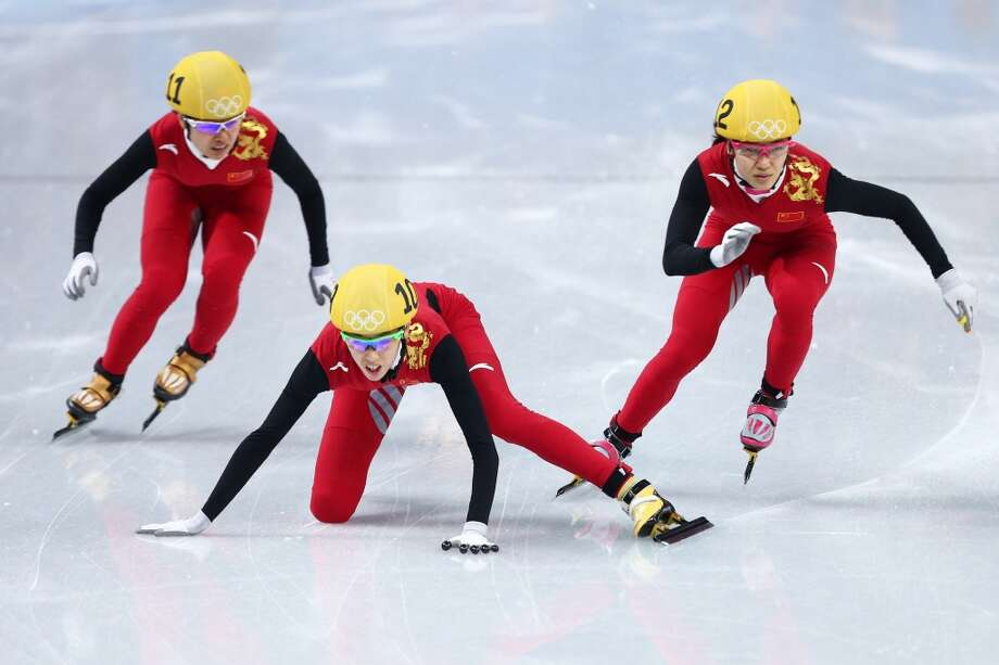 Kexin Fan of China (C) falls as Qiuhong Liu of China (R) Jianrou Li of China (L) race on as they compete in the Short Track Speed Skating Ladies' 500m Semifinal on day 6 of the Sochi 2014 Winter Olympics at at Iceberg Skating Palace on February 13, 2014 in Sochi, Russia.  (Photo by Paul Gilham/Getty Images) Photo: Paul Gilham, Getty Images