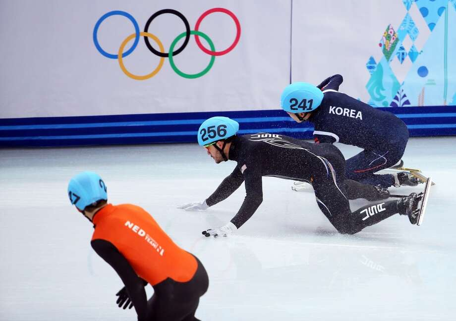 Eduardo Alvarez of the United States and Ho-Suk Lee of South Korea clash and fall as they compete in the Short Track Speed Skating Men's 5000m Relay Semifinal on day 6 of the Sochi 2014 Winter Olympics at at Iceberg Skating Palace on February 13, 2014 in Sochi, Russia.  (Photo by Quinn Rooney/Getty Images) Photo: Quinn Rooney, Getty Images