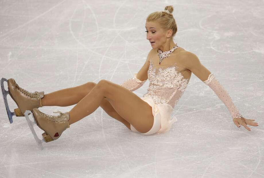 Aliona Savchenko falls as she and Robin Szolkowy of Germany compete in the pairs free skate figure skating competition at the 2014 Winter Olympics, Wednesday, Feb. 12, 2014, in Sochi, Russia. (AP Photo/Bernat Armangue) Photo: Bernat Armangue, Associated Press