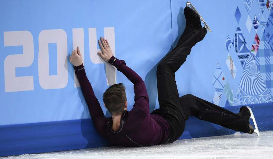 Jeremy Abbott of the United States, crashes into the boards after falling during the men's short program figure skating competition at the Iceberg Skating Palace during the 2014 Winter Olympics, Thursday, Feb. 13, 2014, in Sochi, Russia. (AP Photo/The Canadian Press, Paul Chiasson) Photo: Paul Chiasson, Associated Press