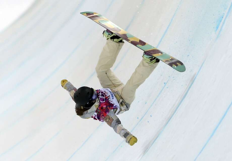 United States' Kelly Clark falls in her first run during the women's snowboard halfpipe final at the Rosa Khutor Extreme Park, at the 2014 Winter Olympics, Wednesday, Feb. 12, 2014, in Krasnaya Polyana, Russia. (AP Photo/Sergei Grits) Photo: Associated Press