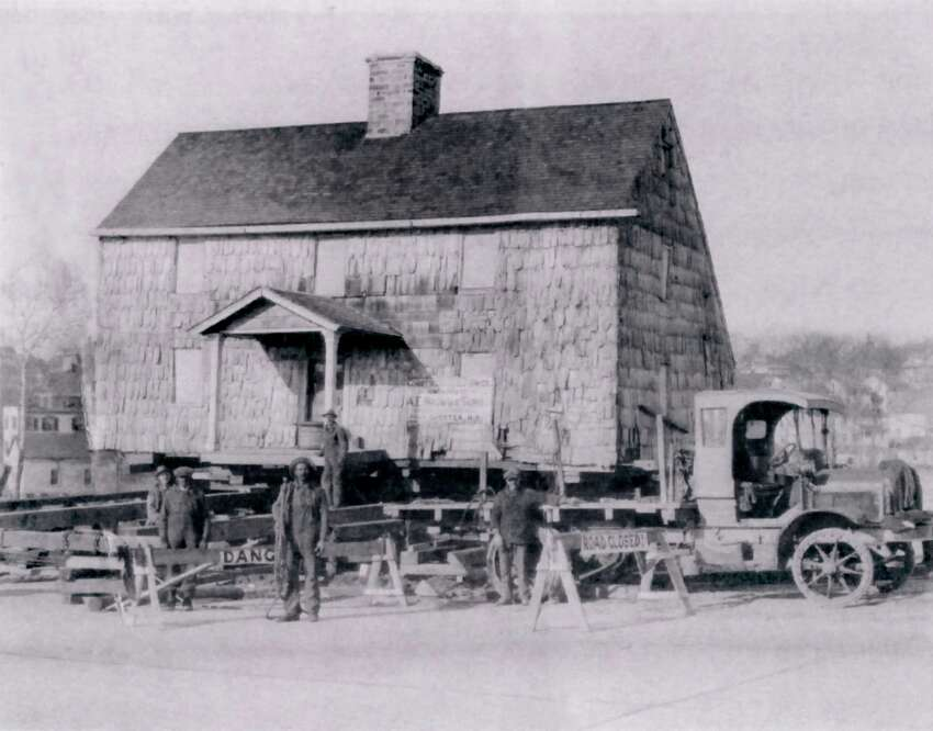 Back in 1914, The Lyon Homestead, probably built around 1700, had already been home to seven generations of the Lyon family. Pictured here is the house being moved in 1927 from its original location on the north side of the Post Road to its current location at 1 Byram Road. Road widening forced the move.