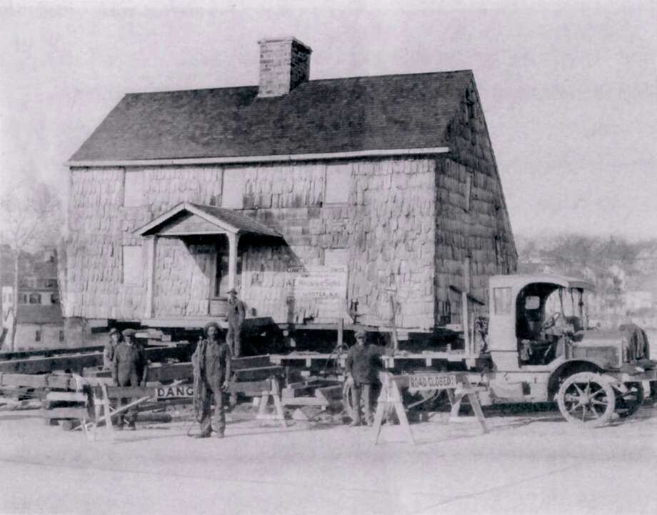 Back in 1914, The Lyon Homestead, probably built around 1700, had already been home to seven generations of the Lyon family. Pictured here is the house being moved in 1927 from its original location on the north side of the Post Road to its current location at 1 Byram Road. Road widening forced the move. Photo: Courtesy Of The Greenwich Histor, Gt / Greenwich Time Contributed