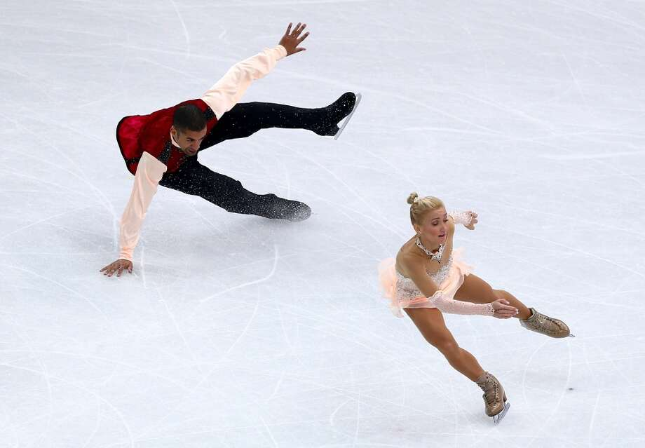Robin Szolkowy (L) of Germany falls while competing with Aliona Savchenko in the Figure Skating Pairs Free Skating during day five of the 2014 Sochi Olympics at Iceberg Skating Palace on February 12, 2014 in Sochi, Russia.  (Photo by Clive Mason/Getty Images) Photo: Clive Mason, Getty Images