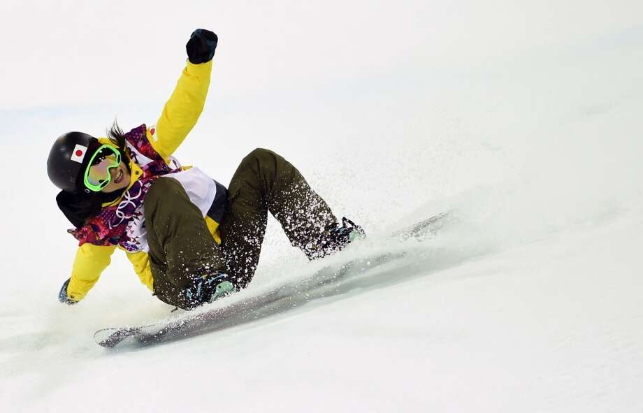 Japan's Rana Okada falls while competing in the Women's Snowboard Halfpipe Semifinals at the Rosa Khutor Extreme Park during the Sochi Winter Olympics on February 12, 2014.  AFP PHOTO / JAVIER SORIANOJAVIER SORIANO/AFP/Getty Images Photo: JAVIER SORIANO, AFP/Getty Images