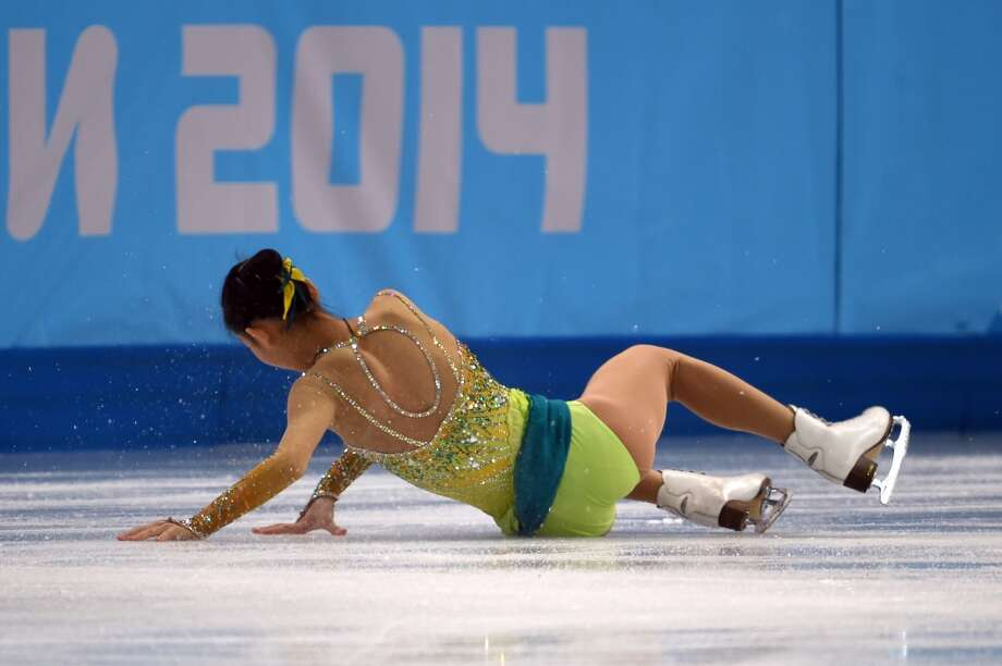 China's Peng Cheng and China's Zhang Hao fall during their Figure Skating Pairs Free Program at the Iceberg Skating Palace during the Sochi Winter Olympics on February 12, 2014.     AFP PHOTO / DAMIEN MEYERDAMIEN MEYER/AFP/Getty Images Photo: DAMIEN MEYER, AFP/Getty Images