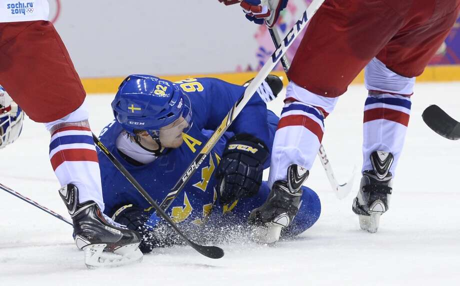 Sweden's Gabriel Landeskog falls during the Men's Ice Hockey Group C match Czech Republic vs Sweden at the Bolshoy Arena during the Sochi Winter Olympics on February 12, 2014.   AFP PHOTO / JONATHAN NACKSTRANDJONATHAN NACKSTRAND/AFP/Getty Images Photo: JONATHAN NACKSTRAND, AFP/Getty Images