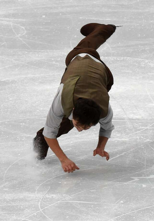 Kazakhstan's Abzal Rakimgaliev falls as he performs in the Men's Figure Skating Free Program at the Iceberg Skating Palace during the Sochi Winter Olympics on February 14, 2014. FP PHOTO / JUNG YEON-JE AFP PHOTO / DAMIEN MEYERDAMIEN MEYER/AFP/Getty Images Photo: DAMIEN MEYER, AFP/Getty Images