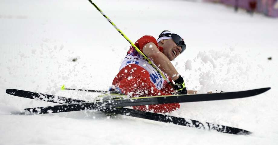 Switzerland's Dario Cologna falls after completing the men's 15K classical-style cross-country race at the 2014 Winter Olympics, Friday, Feb. 14, 2014, in Krasnaya Polyana, Russia. (AP Photo/Gregorio Borgia) Photo: Gregorio Borgia, Associated Press