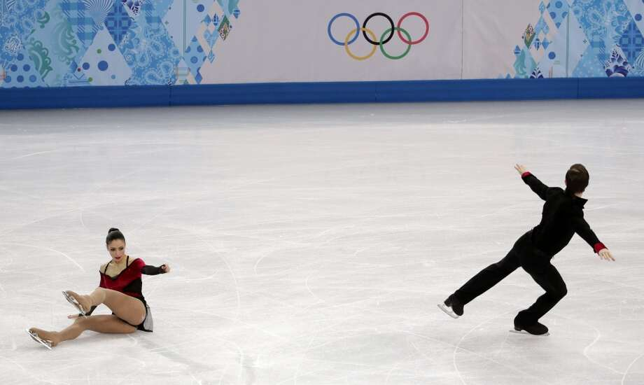 Stefania Berton falls as she and Ondrej Hotarek of Italy compete in the pairs free skate figure skating competition at the 2014 Winter Olympics, Wednesday, Feb. 12, 2014, in Sochi, Russia. (AP Photo/Bernat Armangue) Photo: Bernat Armangue, Associated Press