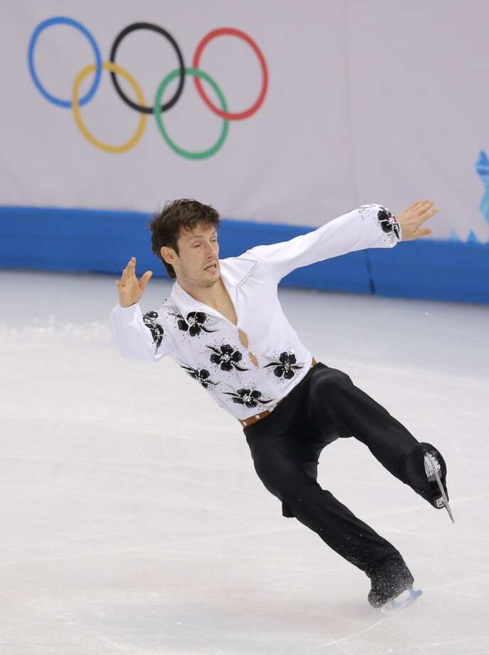 Zoltan Kelemen of Romania falls as he competes in the men's short program figure skating competition at the Iceberg Skating Palace during the 2014 Winter Olympics, Thursday, Feb. 13, 2014, in Sochi, Russia. (AP Photo/Vadim Ghirda) Photo: Vadim Ghirda, Associated Press
