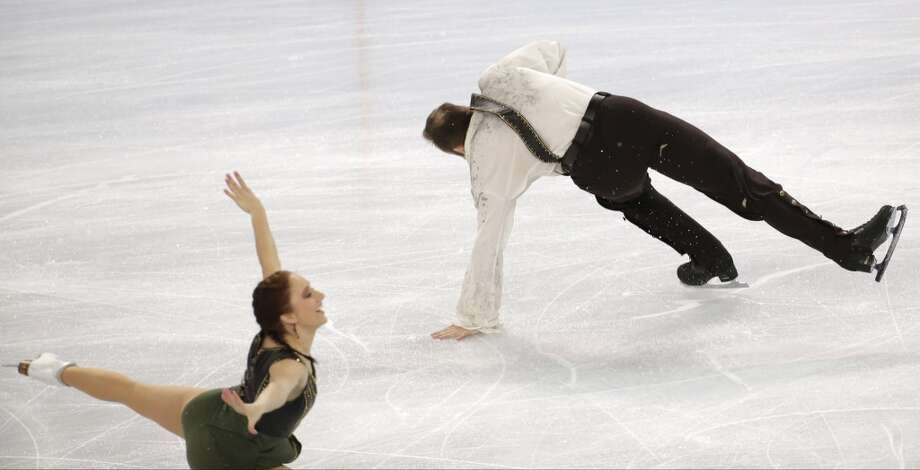 Daniel Wende falls as he and Maylin Wende of Germany compete in the pairs free skate figure skating competition at the 2014 Winter Olympics, Wednesday, Feb. 12, 2014, in Sochi, Russia. (AP Photo/Bernat Armangue) Photo: Bernat Armangue, Associated Press
