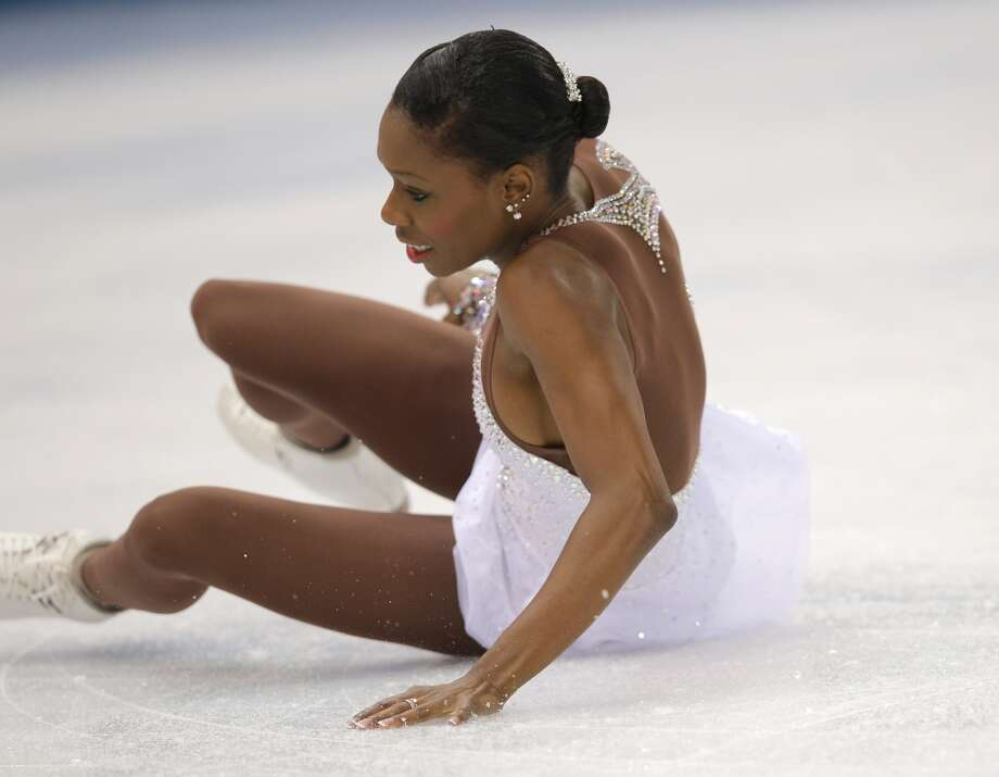Vanessa James falls as she and Morgan Cipres of France compete in the pairs free skate figure skating competition at the Iceberg Skating Palace during the 2014 Winter Olympics, Wednesday, Feb. 12, 2014, in Sochi, Russia. (AP Photo/Vadim Ghirda) Photo: Vadim Ghirda, Associated Press