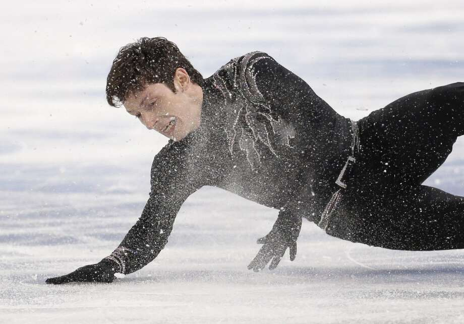 Zoltan Kelemen of Romania falls as he competes in the men's free skate figure skating final at the Iceberg Skating Palace during the 2014 Winter Olympics, Friday, Feb. 14, 2014, in Sochi, Russia. (AP Photo/Bernat Armangue) Photo: Bernat Armangue, Associated Press