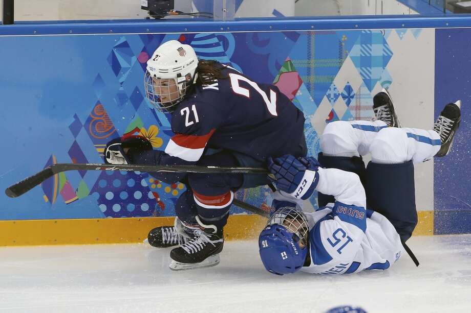 Minnamari Tuominen of Finland falls underneath Hilary Knight of the Untied States during the women's ice hockey game at the Shayba Arena during the 2014 Winter Olympics, Saturday, Feb. 8, 2014, in Sochi, Russia. (AP Photo/Petr David Josek) Photo: Petr David Josek, Associated Press