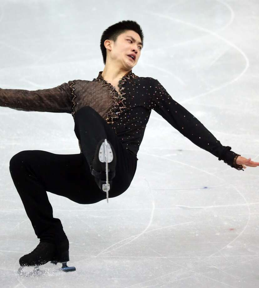 China's Han Yan falls falls during the men's short program figure skating at the Iceberg Skating Palace during the Winter Olympics in Sochi, Russia, Thursday, Feb. 13, 2014. (Brian Cassella/Chicago Tribune/MCT) Photo: McClatchy-Tribune News Service