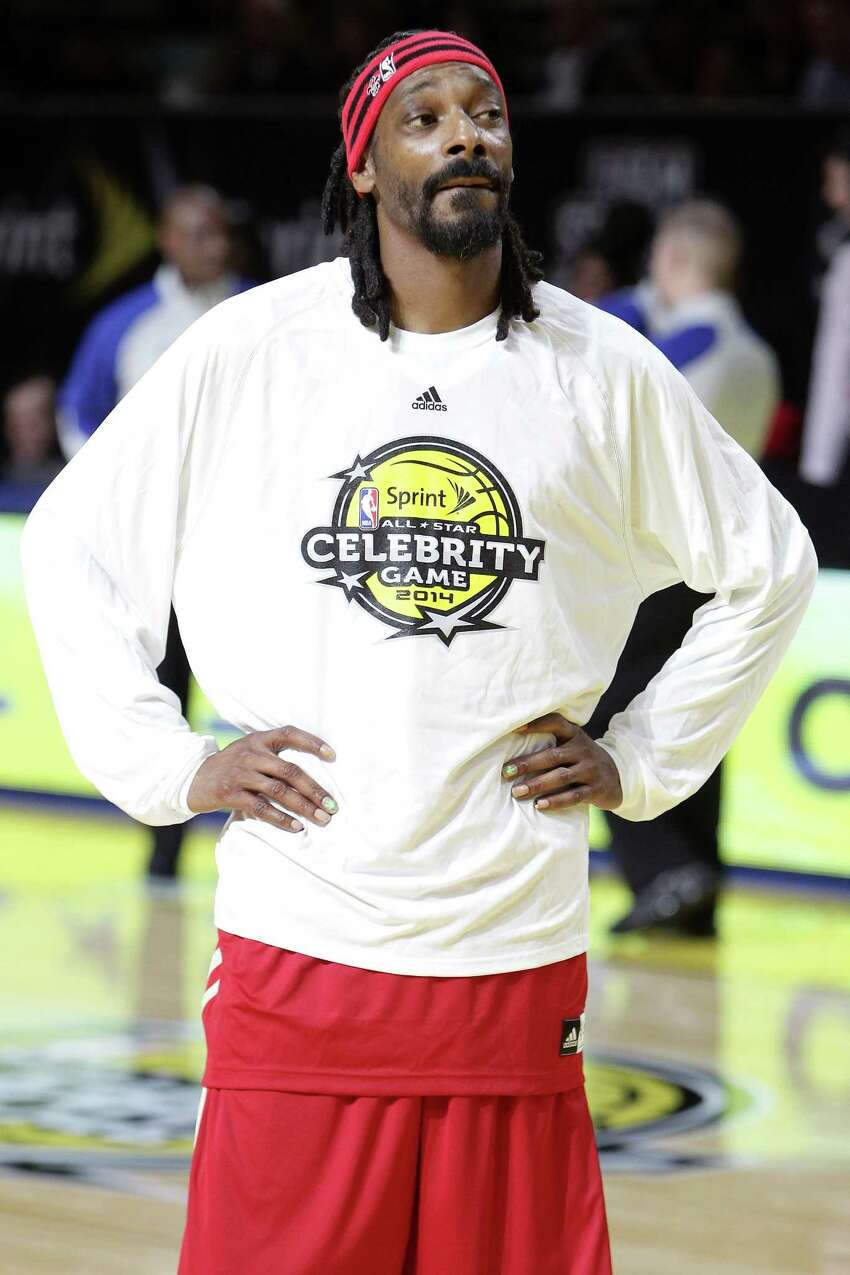 NEW ORLEANS, LA - FEBRUARY 14: Rapper Snoop Dogg participates in the NBA All-Star Celebrity Game 2014 at New Orleans Arena on February 14, 2014 in New Orleans, Louisiana.