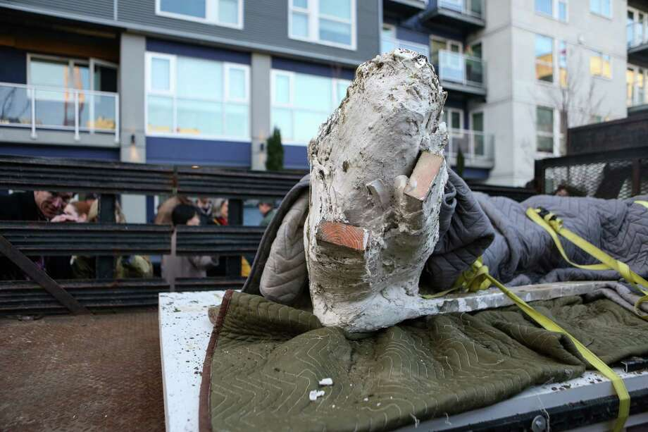 A fossilized and plaster-wrapped mammoth tusk is shown after it was removed. Photo: JOSHUA TRUJILLO, SEATTLEPI.COM / SEATTLEPI.COM