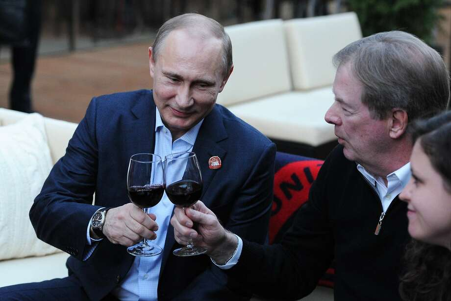 Russian President Vladimir Putin (left) makes a toast with U.S. Olympic Committee Chairman Larry Probst during his visit to USA House. Photo: Mikhail Klimentyev, Associated Press