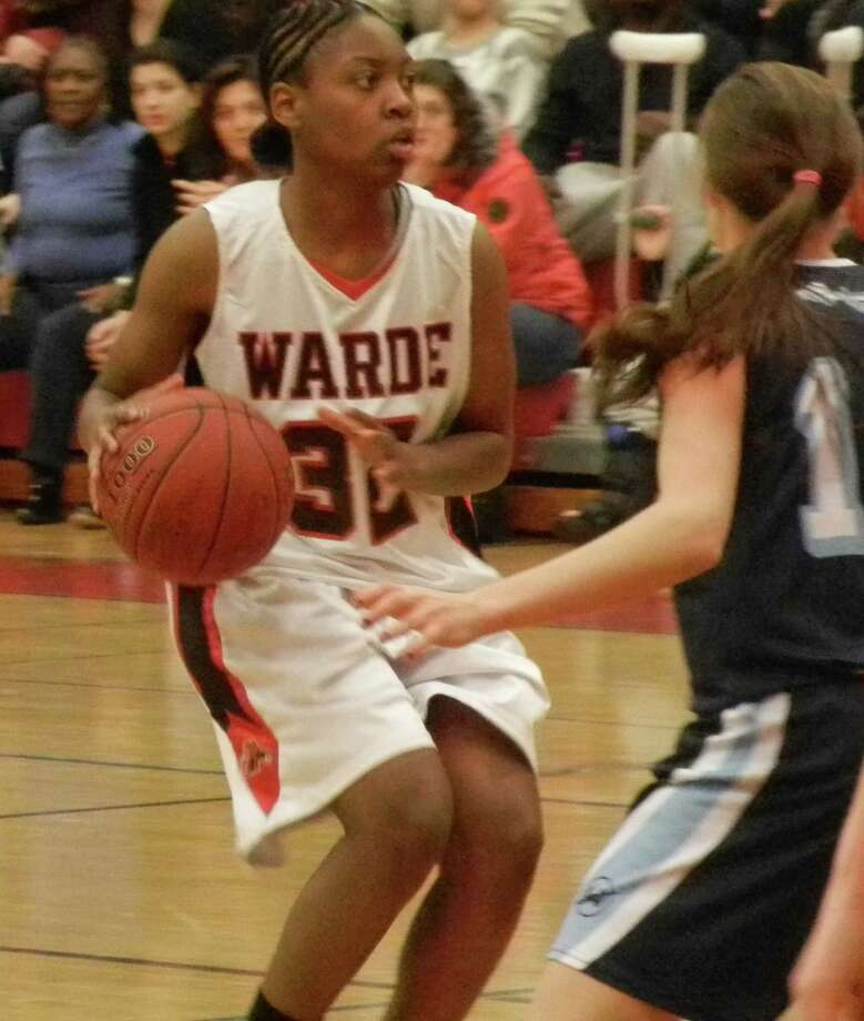 Fairfield Warde senior and co-captain Tiara Fountain (32) about to pick up the dribble during Senior Night in a Mustangs' 41-36 victory over Wilton on Friday, Feb. 14 at Warde. Photo: Reid L. Walmark / Fairfield Citizen