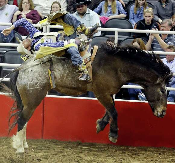 Bobby Mote, of Culver, OR, competes in the bareback riding event during the San Antonio Stock Show &