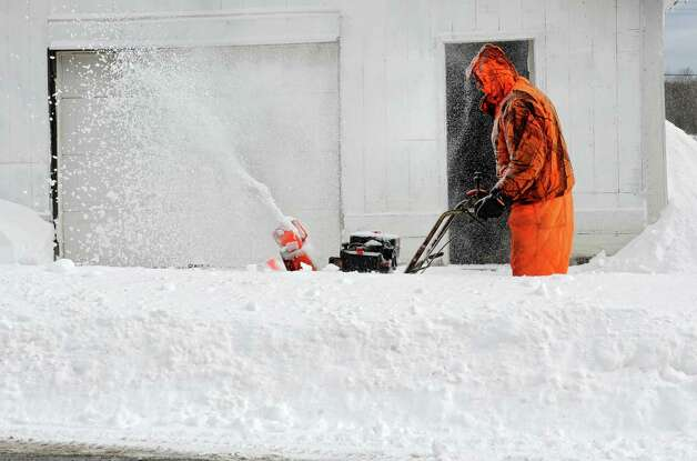 Larry Frok of Knox uses his snowblower in front of his house the morning after a major snow storm Friday, Feb. 14, 2014 in Knox, N.Y.  (Lori Van Buren / Times Union) Photo: Lori Van Buren / 0025756A