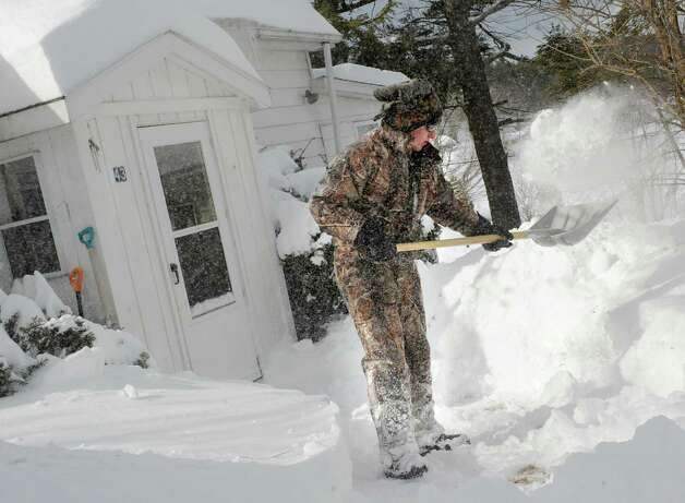 Sam Abbott, 16, of East Berne shoves the sidewalk in front of a neighbor's house on Warners Lake Friday, Feb. 14, 2014, in East Berne, N.Y.  (Lori Van Buren / Times Union) Photo: Lori Van Buren / 0025756A